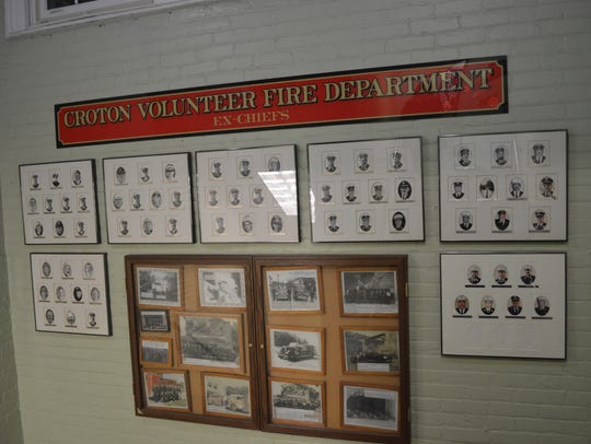 Photos of former Croton fire chiefs hang on a wall