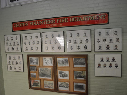 Photos of former Croton fire chiefs hang on a wall in Croton Village Hall.