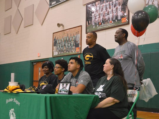 Peabody's Jaimon Cayton (second from left) and Wayne Compton (second from right) sign with Grambling and Mississippi Valley State, respectively, Monday.