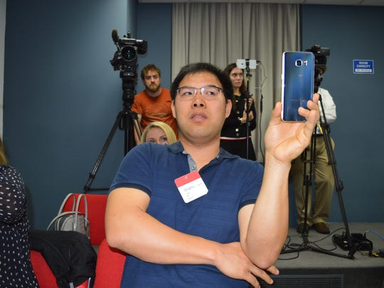 Jonthan Wong, of Purchase, executive director of Citizens for a Responsible Airport, videoed the press conference on his phone.