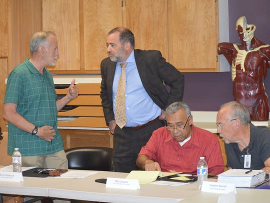Tulare hospital Board President Kevin Northcraft, left,