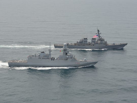 Guided-missile destroyer USS Gonzalez conducts a passing