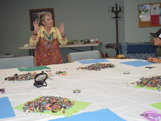 Micki Gilheany leads a jewelry making workshop in Tulare.