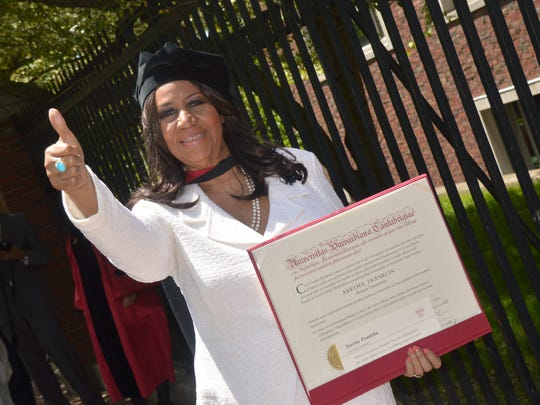 Aretha Franklin gives a thumbs up after receiving an honorary Doctor of Arts degree at Harvard University in 2014.