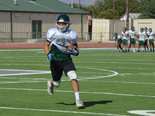 Dinuba High senior Joshua Martinez is expected to be the featured running back of the Emperors' football team this season.