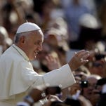 Pope Francis blesses the crowd St. Peter's Square at the Vatican, Wednesday, Oct. 1, 2014.