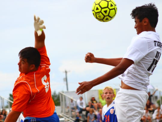 Herbey Bustamante, right, tries to score a goal on a header Saturday afternoon at the Riner Steinoff Soccerplex.