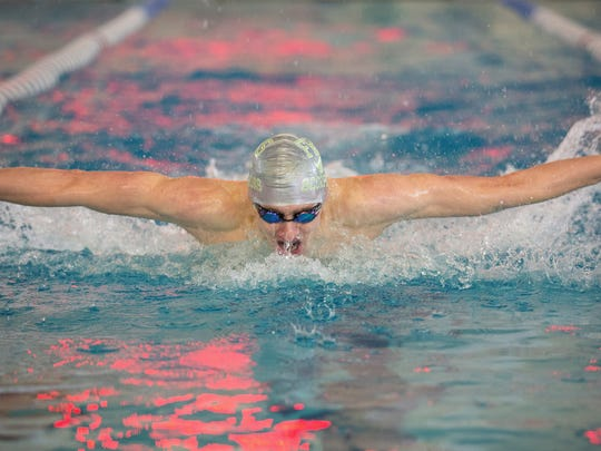 Farmington's Trenton Grossheim competes in the 50-yard butterfly at the Nephi Seavey Invitational on Jan. 28 at the Farmington Aquatic Center.