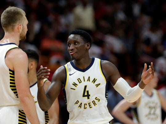 Indiana Pacers' Victor Oladipo (4) talks with Domantas