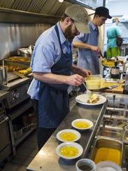 Cook Artie Fleischer works on the line at Down Home