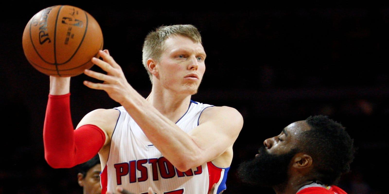 3cb39e3753ea Detroit Pistons  Kyle Singler tosses mask before Houston Rockets game