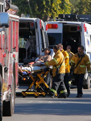 Emergency personnel load a Salinas, Calif., shooting victim onto an ambulance Aug. 27, 2015.