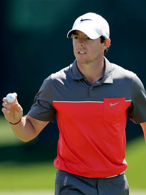 Rory McIlroy waves to the crowd after making par on the 16th hole during the third round of the Wells Fargo Championship golf tournament in Charlotte, N.C., on May 3.