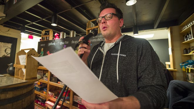 Jarrod Bridgeman, one of Central Indiana's best trivia-night hosts, ask trivial questions to teams of players at Books & Brews in Zionsville on Nov. 27, 2017.