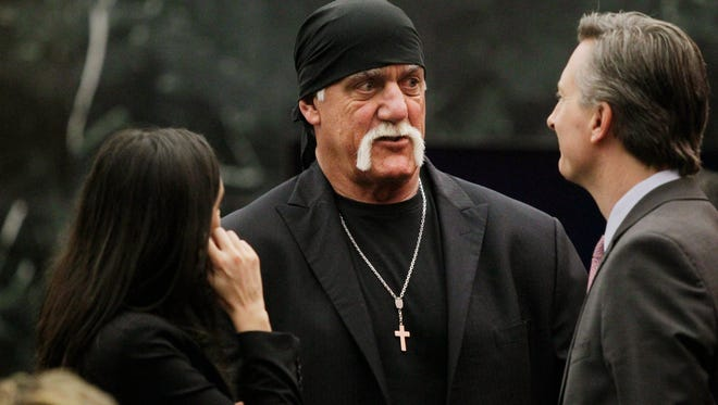 Hulk Hogan talks with his attorneys before the start of his trial Thursday.