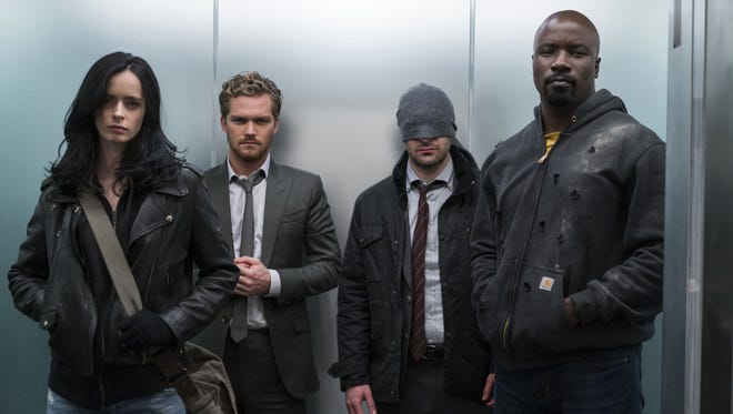 Krysten Ritter (far right), Finn Jones, Charlie Cox and Mike Colter star in 'Marvel's The Defenders.'