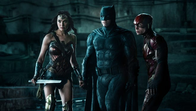 Get ready to rumble! Wonder Woman (Gal Gadot, left), Batman (Ben Affleck) and The Flash (Ezra Miller) report for duty in 'Justice League.'