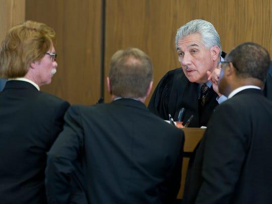 Judge Fernando Macias meets with the attorneys during