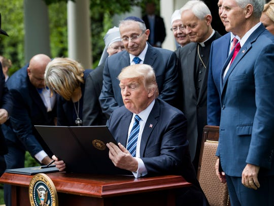 President Trump signs an executive order that the White