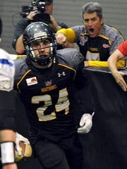 Wichita Falls Nighthawks owner Drew Carnes (right) cheers after James Ackel (24) returns an interception for a touchdown May 2, 2015 at Kay Yeager Coliseum. Carnes announced Tuesday that the Nighthawks would be competing in a new league.