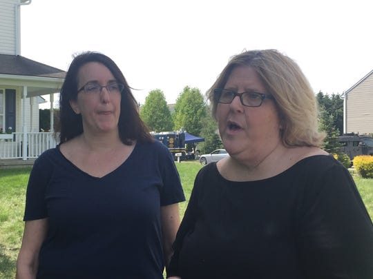 Despite their development being evacuated, Lisa Robinson (left) and Susan Drejka, remained overnight and could hear a lot of what was going on during a nearly 21-hour standoff between police and the man who killed a Delaware State Police trooper.