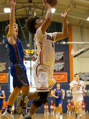 Dickson County's Darian Burns with a lay up against Page. Darian was the leading scorer for the night with 20 points.