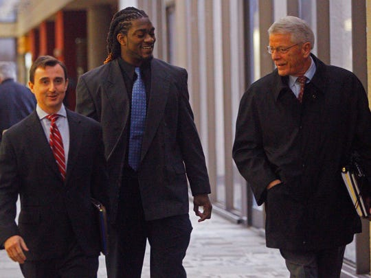 Former University of Tennessee football player A.J. Johnson, center, arrives at criminal court with attorneys Tom Dillard, right, and Steve Johnson on March 9 in Knoxville.