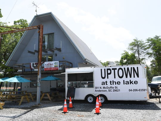 The Uptown at the lake trailer serves food during the