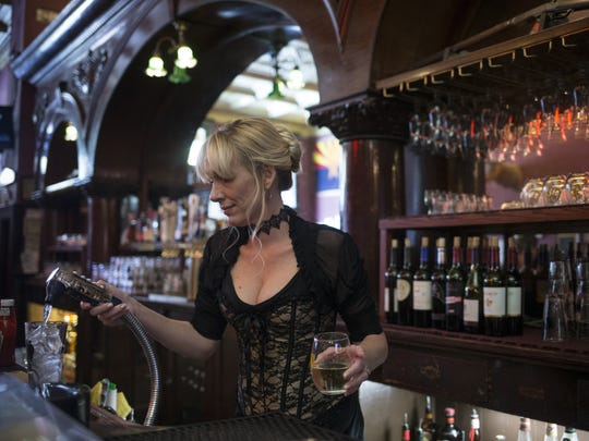 Martha Mekeel works the bar, November 6, 2017, at the Palace Saloon and Restaurant 120 S. Montezuma Street, Prescott, Arizona.
