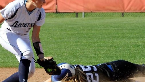 Airline's Kaitlyn Walker tries to apply a tag to Evangel's Leanna Cooper during Wednesday's game at Evangel. The Lady Eagles won the District 1-5A contest 8-7.