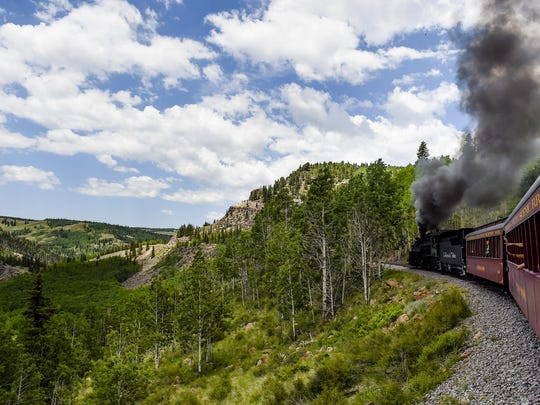 A train chugs along the Cumbres & Toltec Scenic Railroad, which weaves through the mountains between Antonito, Colorado, and Chama, New Mexico.