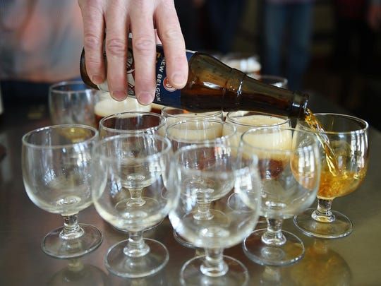Samples of Fat Tire are poured on a tour of New Belgium