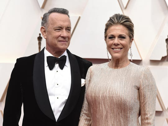 "FILE - In this Feb. 9, 2020 file photo, Tom Hanks, left, and Rita Wilson arrive at the Oscars at the Dolby Theatre in Los Angeles. The couple have tested positive for the coronavirus, the actor said in a statement Wednesday, March 11. The 63-year-old actor said they will be ""tested, observed and isolated for as long as public health and safety requires."" (Photo by Jordan Strauss/Invision/AP, File)"