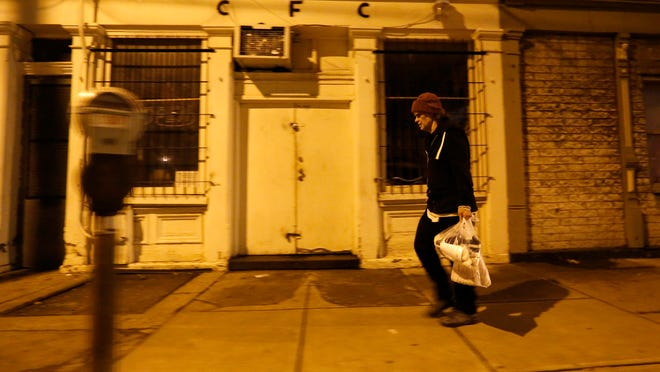 Jonathan Kovac, who has been homeless for  four years, walks  on Vine Street to Corryville . Advocates are working to find him housing.