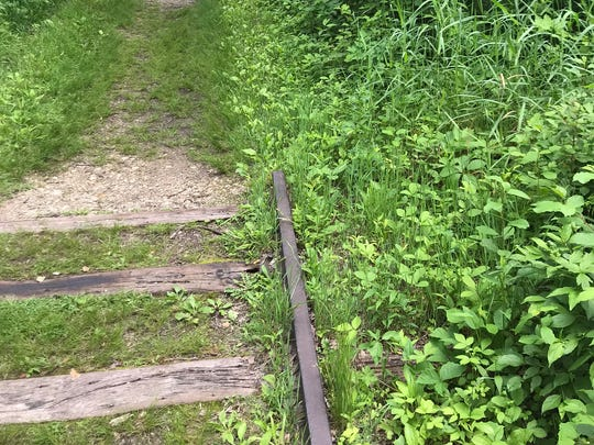 Railroad tracks that lead to nowhere are a fascinating and haunting way to interest your kids in a nature hike.