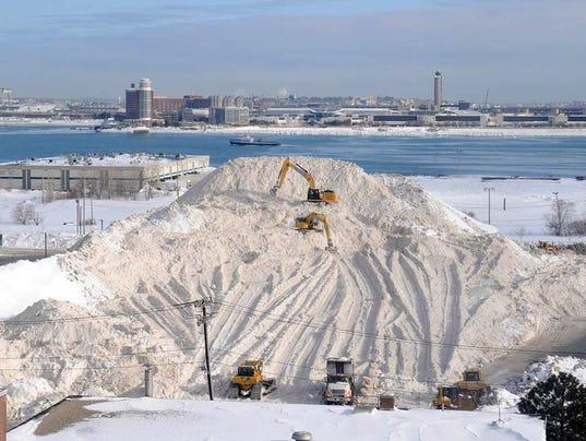 AP ODD DIRTY SNOW PILE