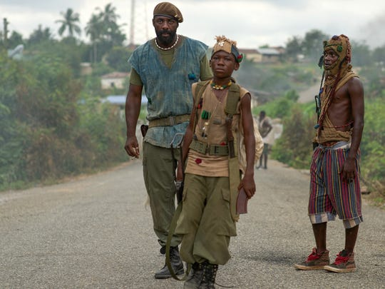 "Idris Elba and Abraham Attah in the Netflix original film ""Beasts of No Nation."""