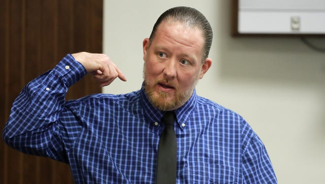 George Burch points to the back of his head where he claims he was hit by Douglass Detrie on the night that Nicole VanderHeyden was killed in 2016. Burch testified Wednesday during his trial for  VanderHeyden's murder in 2016.