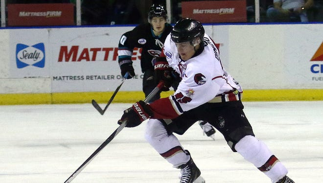 IceRays defenseman Jayson DiMizio brings the puck up against Shreveport during the first period Thursday, Dec. 29, 2016, at the American Bank Center in Corpus Christi.