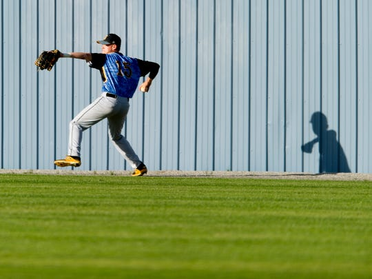 Gibbs' Will McSwain (15) throws a ball hit into the