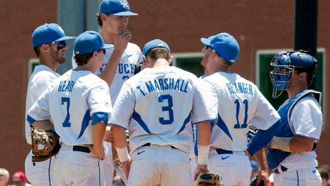 Kentucky assistant baseball coach Jim Belanger (#11) comes out to the mound to calm University of Kentucky starting pitcher Sean Hjelle, top.10 June 2017
