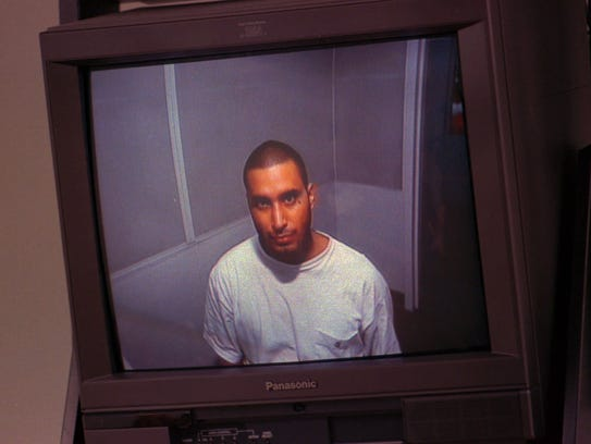 John Ortiz-Kehoe  appears on a television monitor during