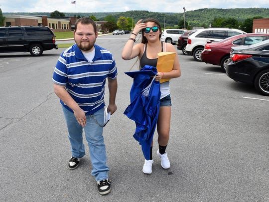 Michael Vanderweele walks across McConnellsburg High School campus with his sister, Sydni, Friday, June 2, 2017. Vanderweele finished the requirements to graduate from Forbes Road High School, but he attended special classes at McConnellsburg. Since he graduated during a ceremonial event in 2014, MHS will not let him walk again with students.
