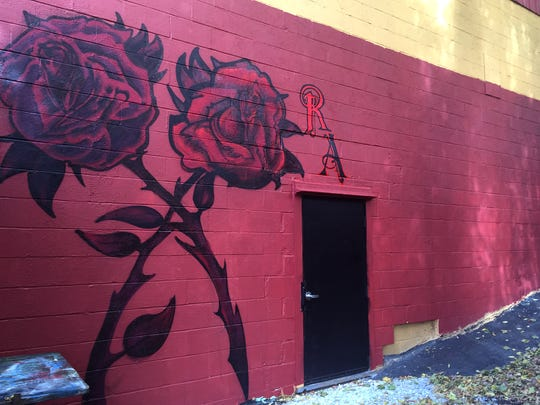 Rubra Atra, a new coffee shop on Pine Street, is tucked in the back of the former soda plant building. The entrance is a discreet back door marked by a black and red rose on the brick building.