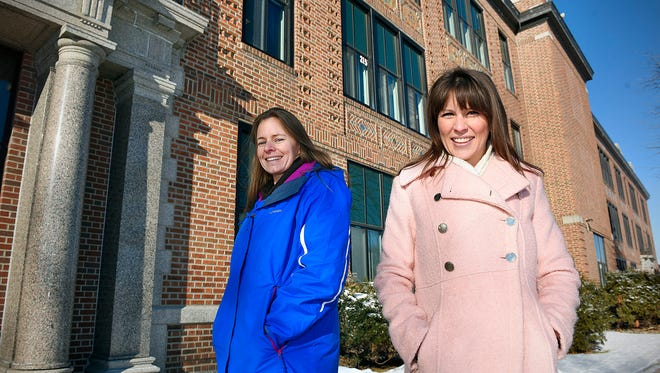 After a building tour, Sarah Murphy, an architect from Colorado, and Claire VanderEyk, who has a master's degree in historical preservation, Tuesday, Jan. 12, at Technical High School. The two Tech graduates are looking for ways to renovate the 100-year-old Tech building for future use as a high school.