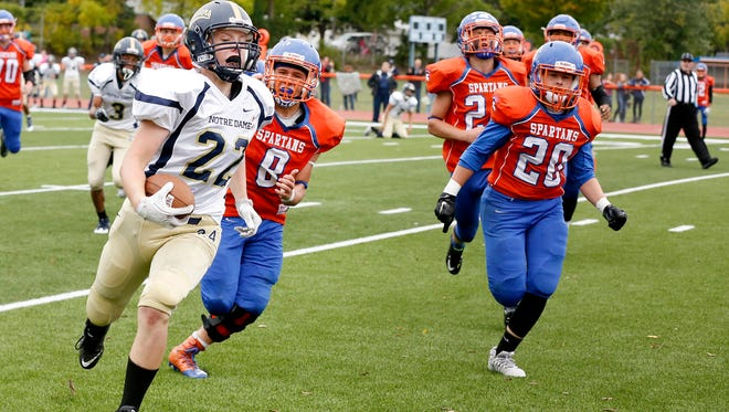 Notre Dame's Erik Charnetski runs into the end zone while being chased by a squad of Thomas A. Edison players Saturday.