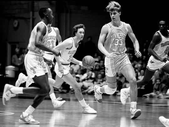 Vanderbilt guard Barry Goheen, center, tries to get past Tennessee teammates Tony White, left, and Mark Griffith (33) during a game at Memorial Gym on Jan. 3, 1987. UT won 81-72.