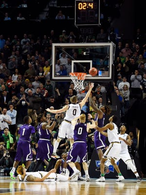 Notre Dame Fighting Irish guard Rex Pflueger (0) tips in the winning basket against the Stephen F. Austin Lumberjacks during the second half in the second round of the 2016 NCAA Tournament at Barclays Center.