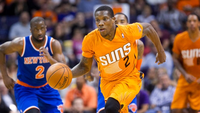 The Suns' Eric Bledsoe dribbles in front of the Knicks Raymond Felton during the first half at the US Airways Center in Phoenix on Friday, March 28, 2014.