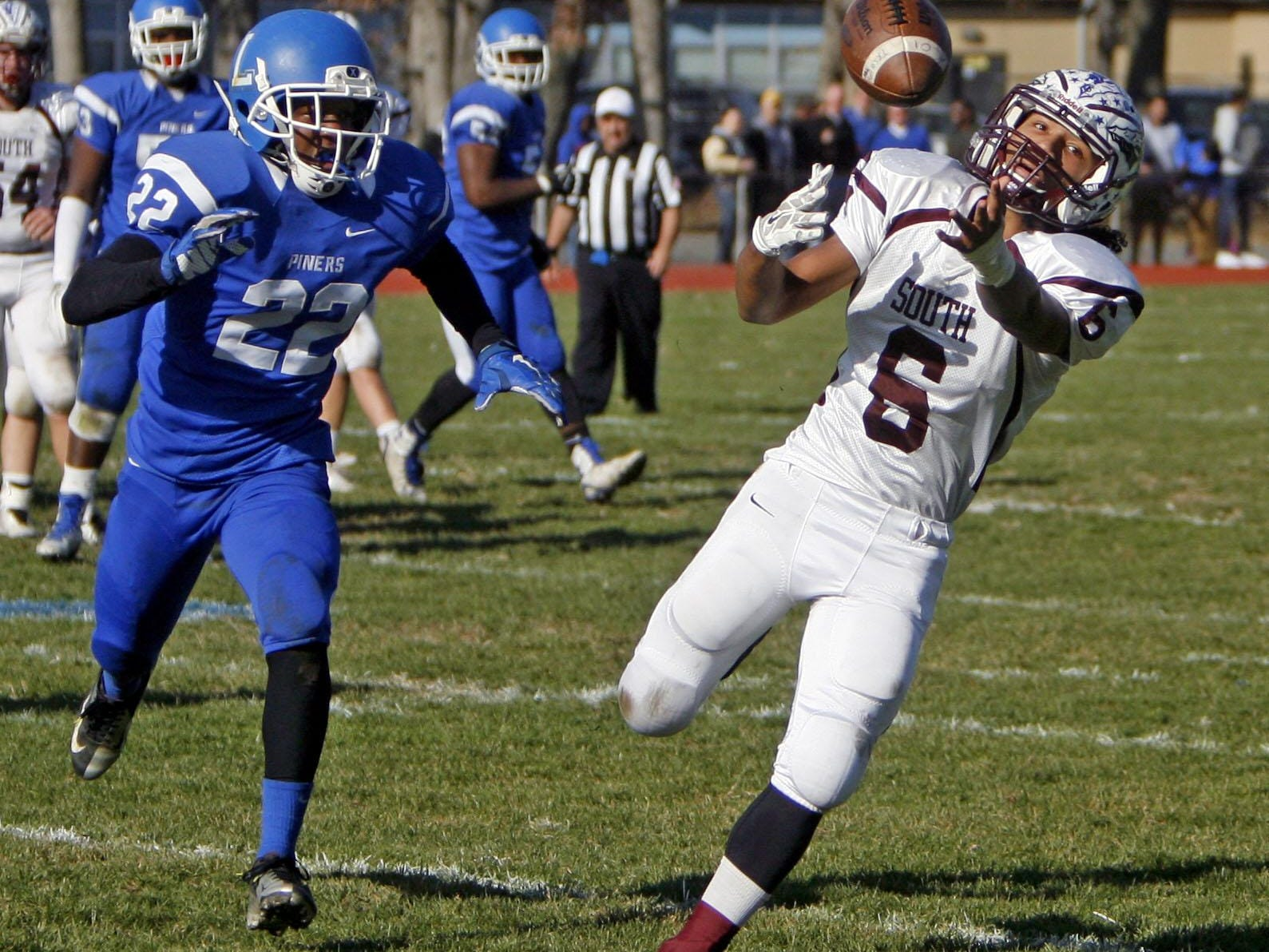 Toms River South's Dashaun Alexander (6), right, is just out of reach of a pass at Lakewood High School Nov. 26, 2015. Covering left is Lakewood's Ja'shon Fisher. Photo by Vincent DiSalvio / Special to The ASBURY PARK PRESS
